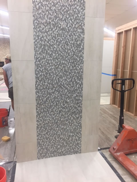 This bathroom display features 12x24 tile with a 2 foot wide strip of glass. Our new showroom will feature twelve of these 4 foot displays as well is six 8-foot bathroom displays.
